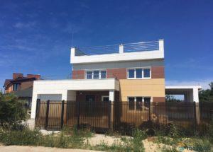 дом с гаражом и плоской крышей