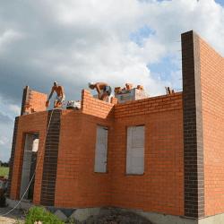Кладка стен двухэтажного дома